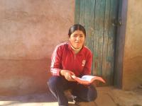Nancy Mamani Aspi in front of her home